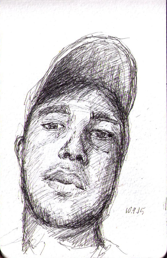Drawing of a guy wearing a hat in ballpoint pen