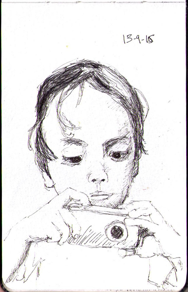 Drawing of a little boy with a camera in ballpoint pen