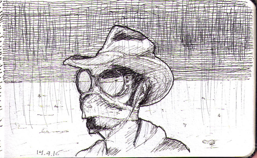 Drawing of a man in cowboy hat in the dessert in ballpoint pen